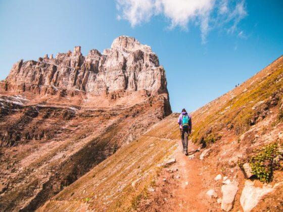 Person walking on mountain trail